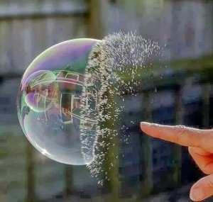 slow-motion picture of a bubble being burst